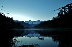 Lake Matheson is so still that it throws wonderful reflections of Aoraki/Mt Cook and Mt Tasman in the main divide of the Southern Alps of New Zealand.  We had to walk in pre-dawn to capture this image - fortunately the track was excellent!